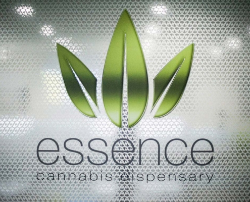 essence cannabis dispensay window sign