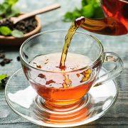 Pouring Tea in Teapot