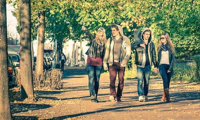 Group Of Teenagers Walking In The Street